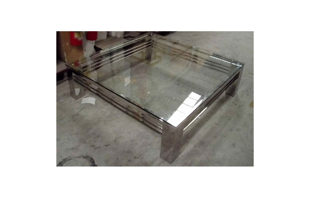 Table basse en verre transparent et pieds en acier inox for Table basse salon en verre